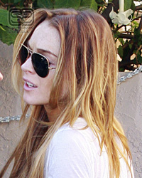 Lindsay Lohan wearing Ray Ban 3025 Aviators
